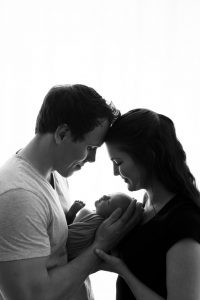 posed newborn photography in studio with family