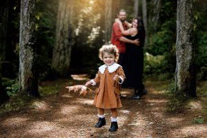 Outdoor family photography. forest session. toddler and parent image in treed area