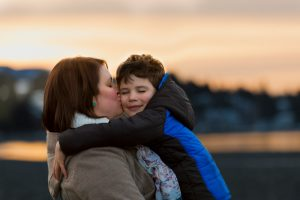 Mother and son family sunset beach portrait