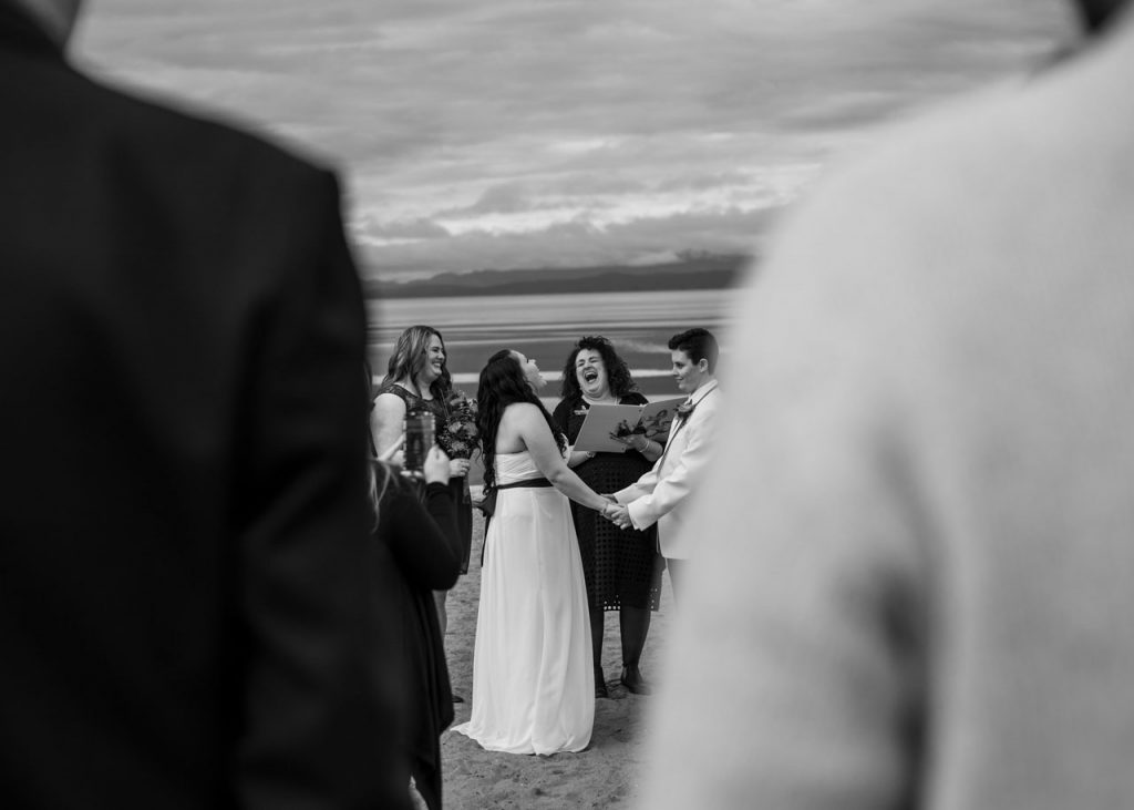 Black and white Parksville wedding photograph of couple getting married on beach