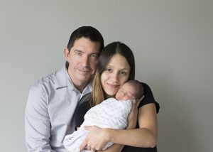 Newborn photo of mother, father, and newborn baby