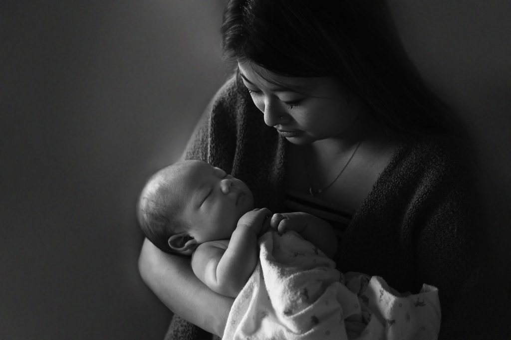 Newborn baby photo of baby in mother's arms